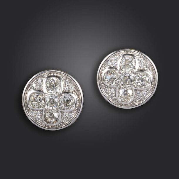 A pair of diamond set disc earrings, set with a quatrefoil of old cushion shaped…