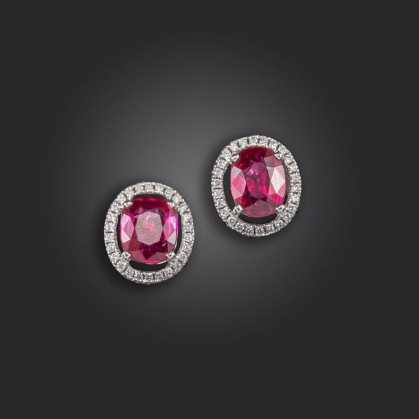 A pair of synthetic ruby and diamond set cluster ear studs, the oval shaped rubi…