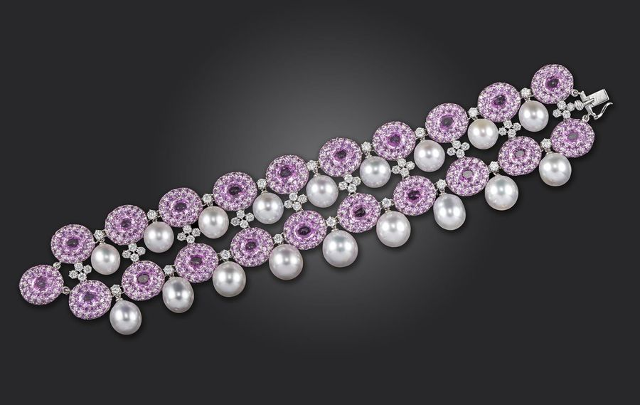 A pink sapphire and diamond bracelet by Scavia, the two rows of pink sapphire cl…