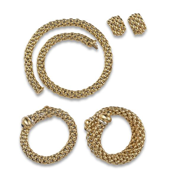A gold suite of jewellery by Fope, including a bi colour gold mesh link necklace…