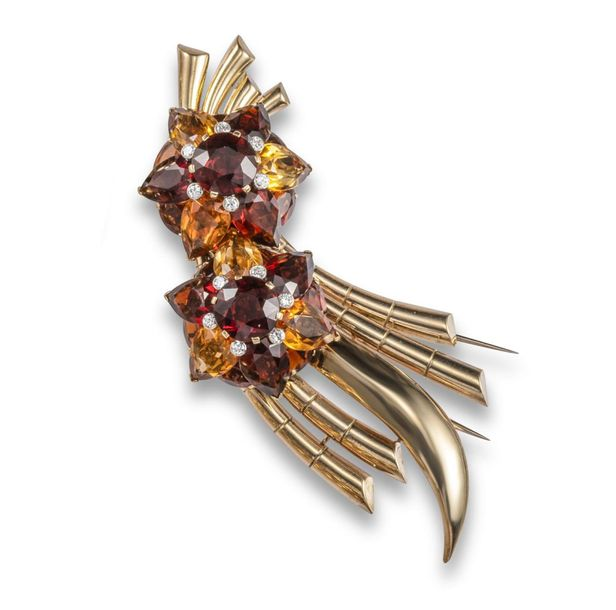 A citrine and diamond spray brooch, c1940, mounted with two foliate clusters set…