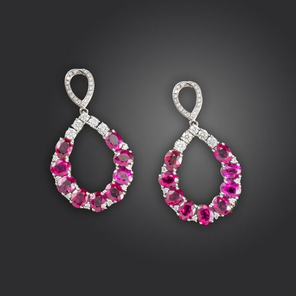 A pair of ruby and diamond drop earrings, the pear shaped drop sections set with…