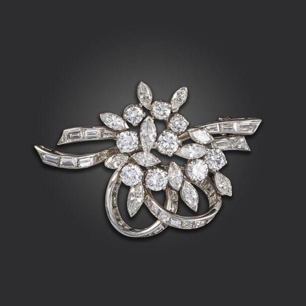 A diamond spray brooch, set with graduated marquise, circular and baguette shape…