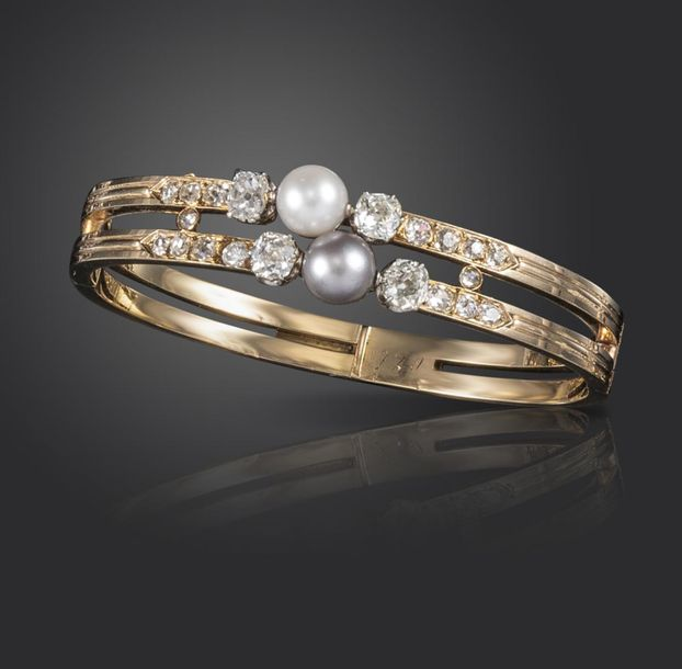 A 19th century French natural pearl and diamond bangle, set with a white pearl a…