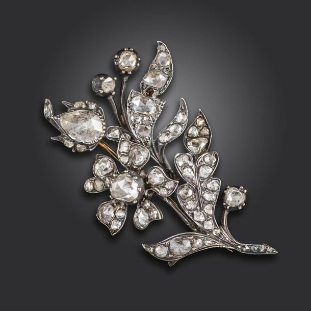 An early 19th century diamond set foliate brooch, the floral spray set overall w…