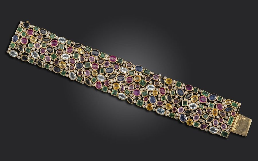 A gem set gold bracelet, set with round brilliant cut diamonds, square shaped em…