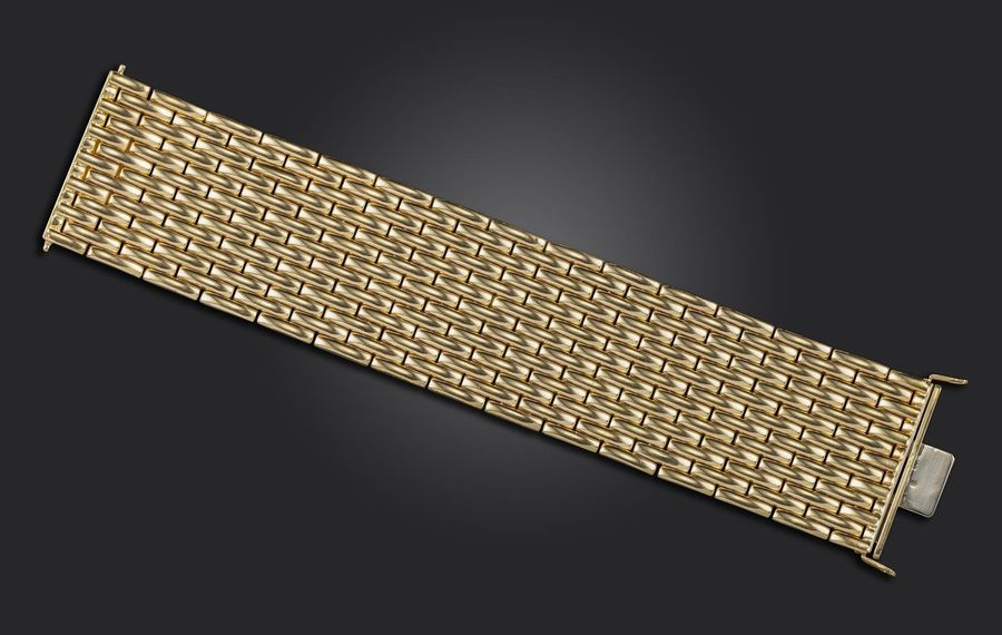 A wide gold bracelet by Superoro, designed as polished gold brick links in 18ct …