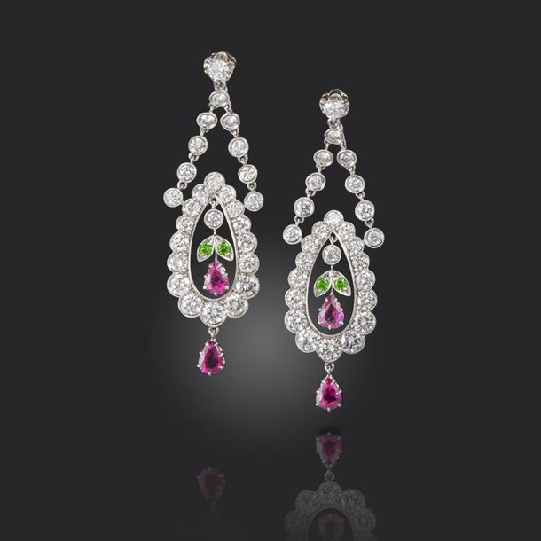 A pair of gem set drop earrings, of openwork foliate design, set with round bril…