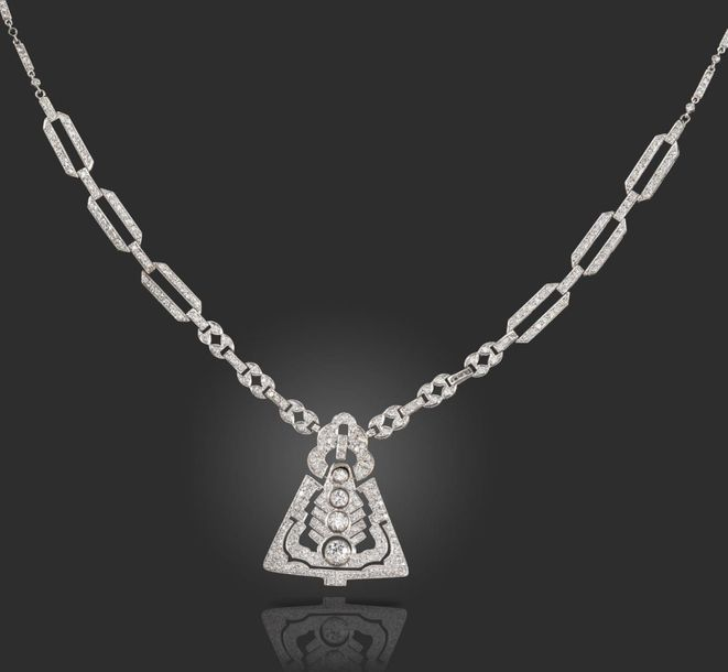 A diamond set white gold necklace, the triangular shaped pendant of geometric op…