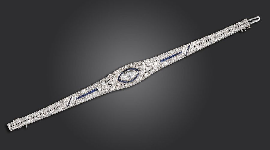 A diamond and sapphire bracelet, centred with a marquise shaped diamond weighing…