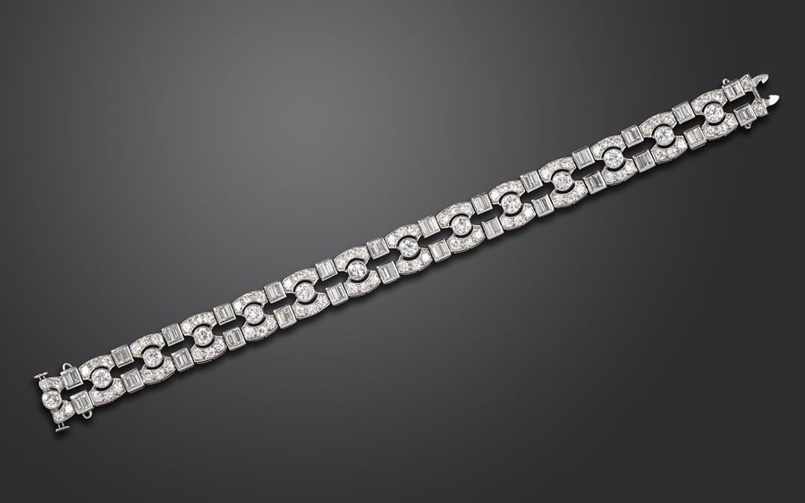 An Art Deco diamond bracelet, mounted with graduated circular cut and baguette s…