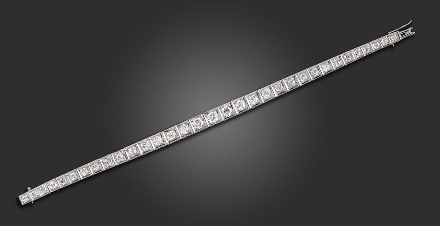 A diamond line bracelet, set with graduated old circular cut diamonds in square …