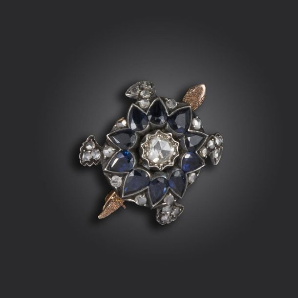 A late 19th century sapphire and diamond set turtle brooch, the body centred wit…