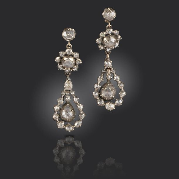 A pair of diamond drop earrings, probably Iberian 18th century, of three section…