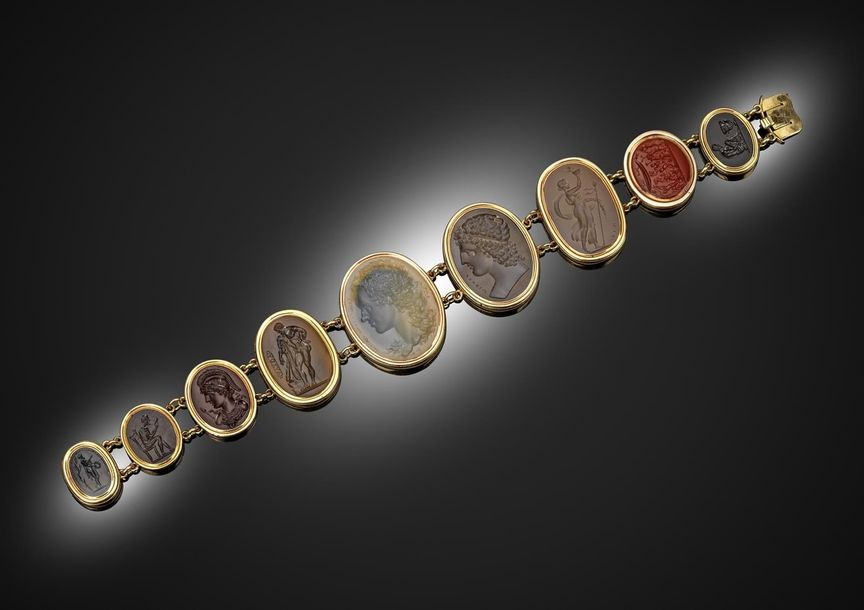 A 19th century bracelet mounted with nine oval hardstone intaglios in gold rub o…