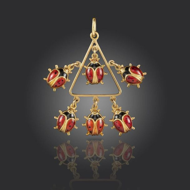 A gold and enamel ladybird pendant, the triangular centre section suspends six l…