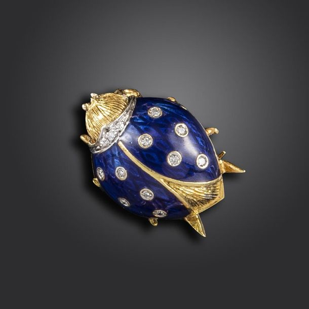 A diamond and blue enamel ladybird brooch by Van Cleef & Arpels, in textured yel…