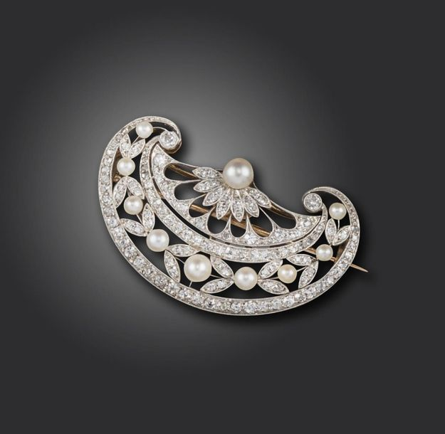 A Belle Epoque pearl and diamond brooch, the stylised fan is pierced and set wit…