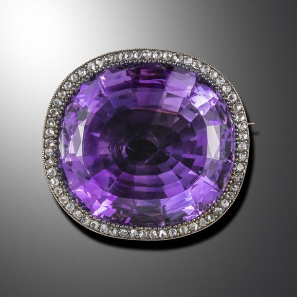 A late Victorian large amethyst and diamond brooch pendant, the cushion shaped a…