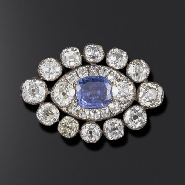 A George III sapphire and diamond brooch, the lozenge set with graduated old cus…