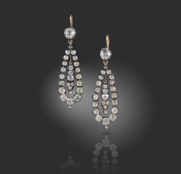 A pair of 19th century diamond drop earrings, set with graduated old cushion sha…