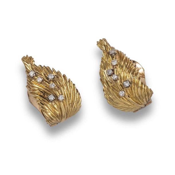 A pair of diamond set gold earrings by Van Cleef & Arpels, the textured yellow g…