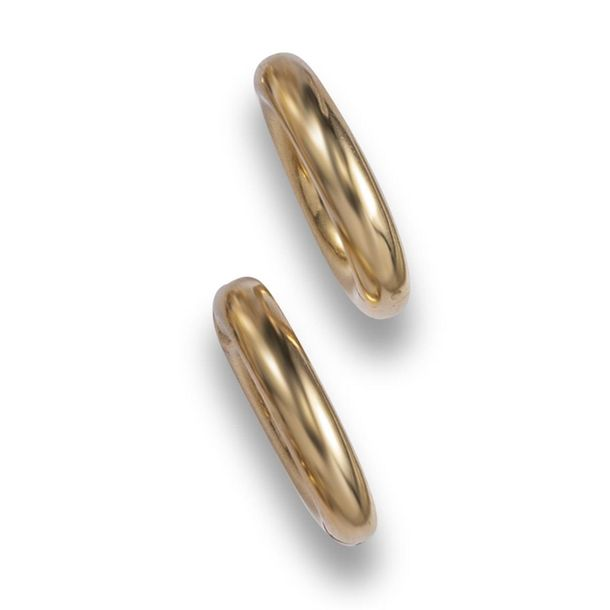 A pair of gold hoop earrings by Cartier, the hollow gold hoop clips with invisib…