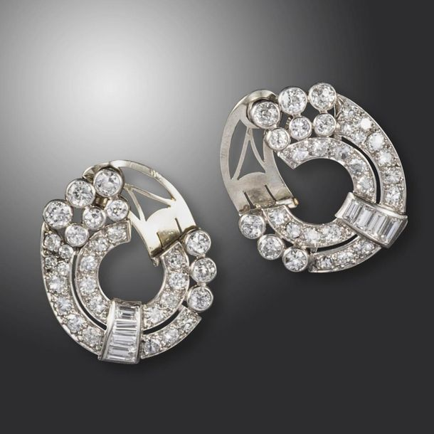 A pair of diamond set circular ear clips, c1940, the concentric circles set with…