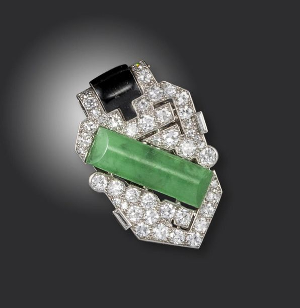 An Art Deco jade, diamond and black enamel clip brooch by Cartier, of geometric …