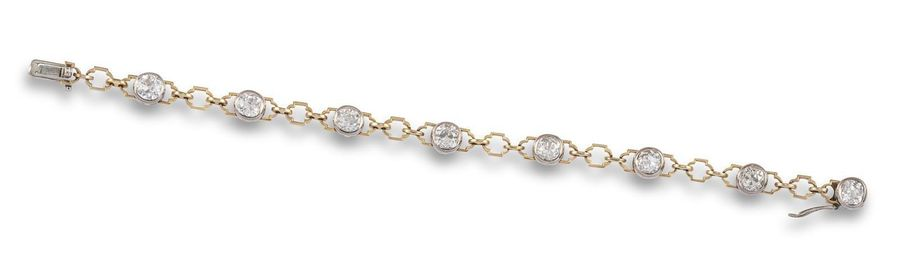 A diamond line bracelet, the eight old circular cut diamonds set in platinum col…