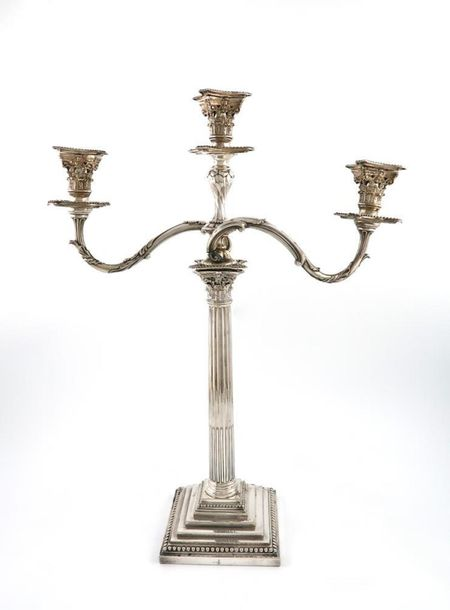 A Victorian electroplated three light candelabrum, by H and L, Corinthian column…