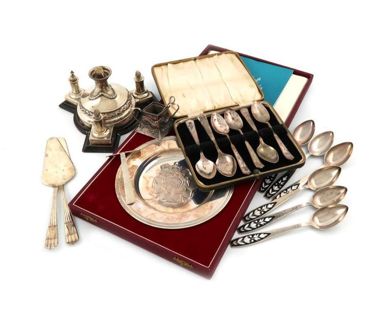 A mixed lot, comprising silver items: a Victorian table cigar lighter, by E. Hut…