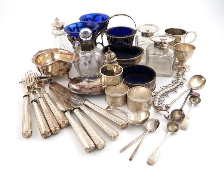A mixed lot of silver items, various dates and makers, comprising: a pair of sil…