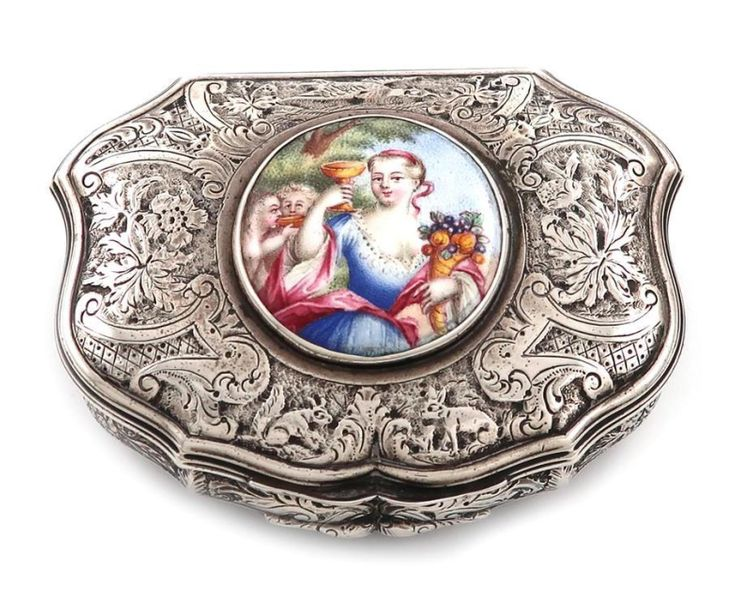 A silver and enamel snuff box, unmarked, probably 18th century cartouche shaped,…