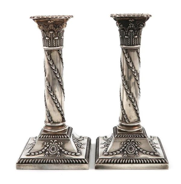 A pair of late Victorian silver candlesticks, by H. Atkin, Sheffield 1899, Corin…