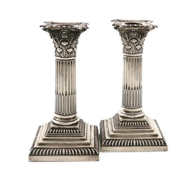 A matched pair of late Victorian silver candlesticks, by William Hutton and Sons…