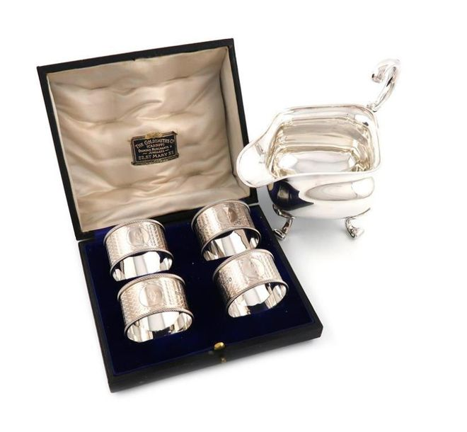 A cased set of four silver napkin rings, by Martin, Hall and Co, Sheffield 1918,…
