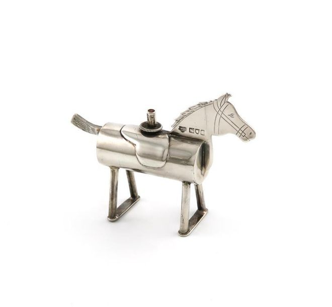 An Edwardian novelty silver table cigar lighter, by the Goldsmiths and Silversmi…
