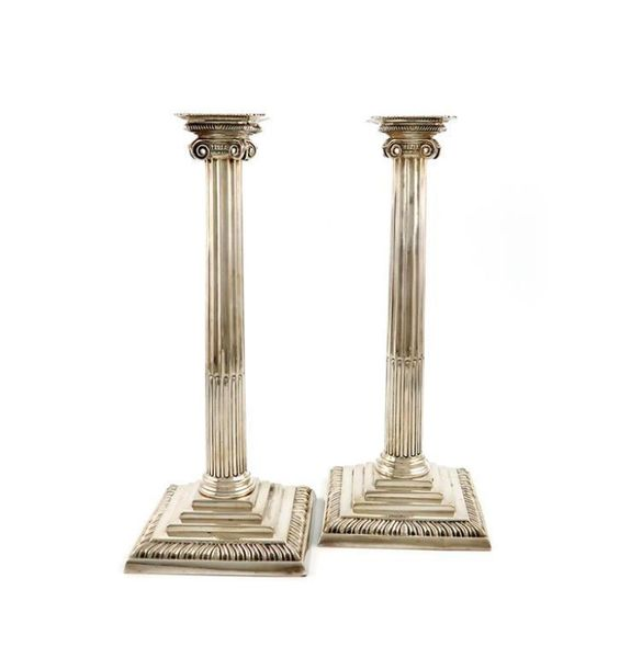 A pair of George III silver candlesticks, by Ebenezer Coker, London 1765, fluted…