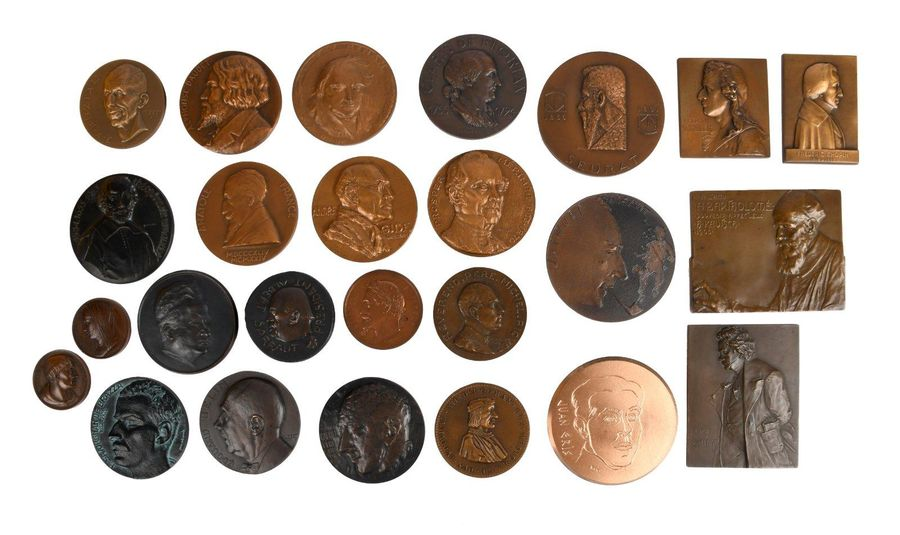 A collection of continental bronze portrait and memorial medals and plaques, sub…