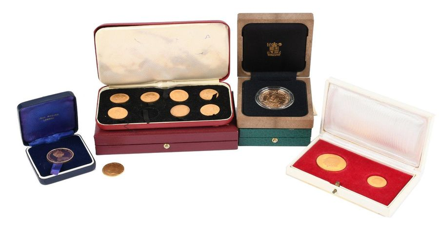 A collection of gold coins and commemorative medals, comprising: George III, gui…