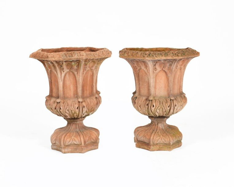 A pair of terracotta garden urns in the manner of Royal Doulton, octagonal secti…