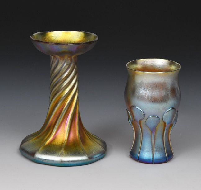 A Louis Comfort Tiffany Favrile glass vase, twisted form with flaring top rim, a…