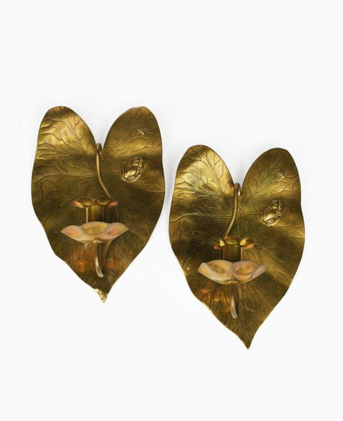 A pair of Aesthetic Movement brass wall sconces probably retailed by Liberty & C…