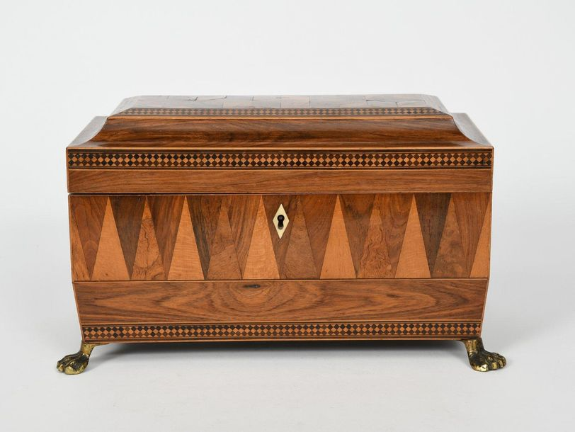 Λ A Tunbridge Ware marquetry Sarcophagus shape tea caddy, on brass claw feet, re…