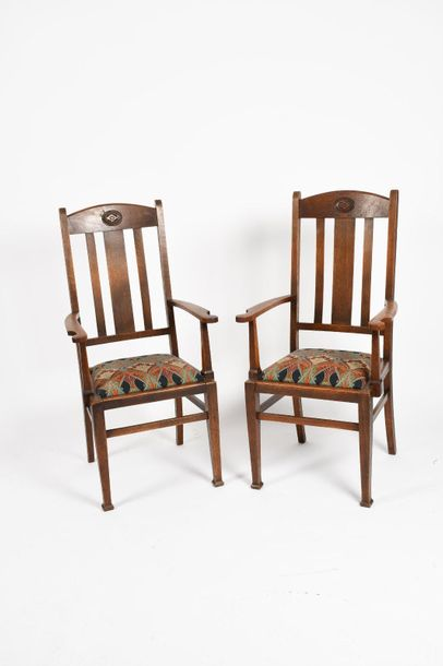 A Heal's polished oak Letchworth table, and four en suite chairs and two carvers…