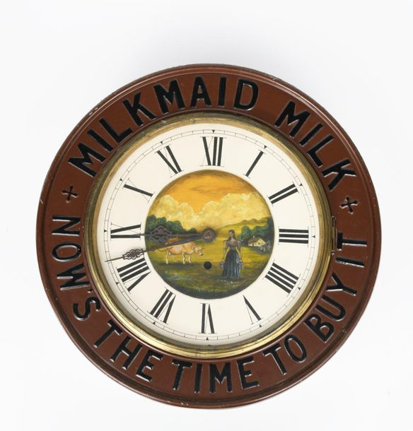 Milkmaid Milk Now's the Time to Buy an advertising wall clock, circular form, st…