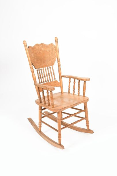 An ash rocking chair, shaped seat on turned legs and stretchers, the back carved…