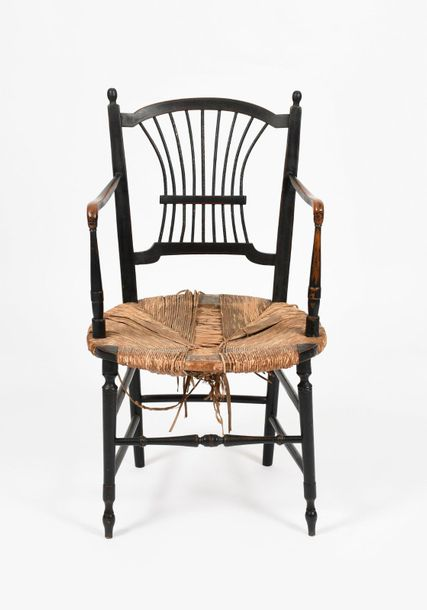 A Morris & Co Sussex ebonised wood Rossetti arm chair, possibly designed by Dant…