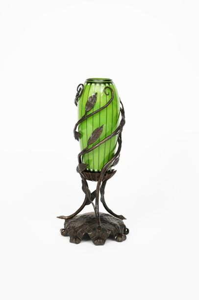 An Austrian Secessionist glass vase with wrought iron mount, slender, swollen gr…